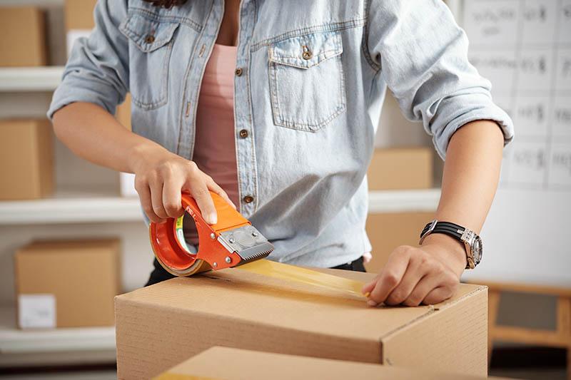 Applying tape on package