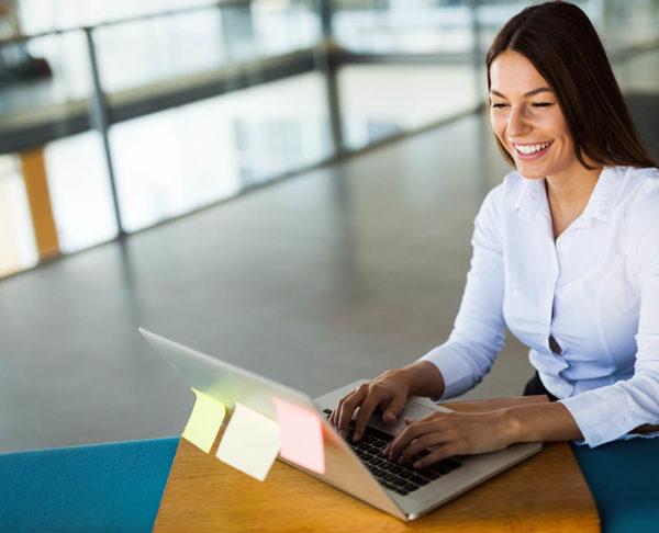 Portrait of businesswoman working on computer in modern office