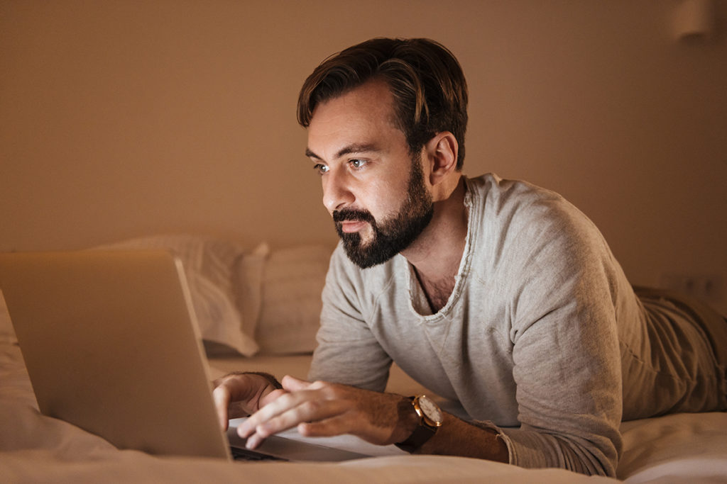 Portrait of a concentrated man using laptop computer